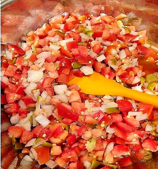 Mixing Fresh Tomato Salsa Ingredients in Large Bowl