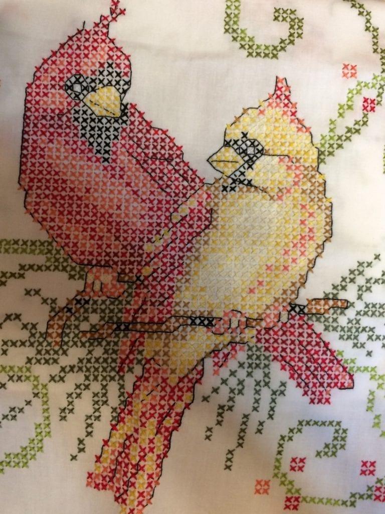 close up of cardinal cross stitch