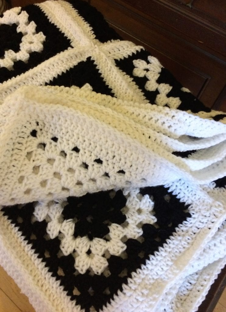 Finished black and white granny square afghan
