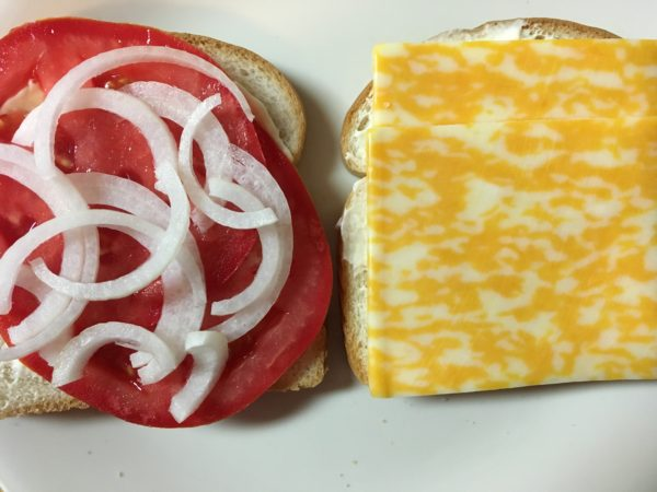 Onions on tomato sandwich