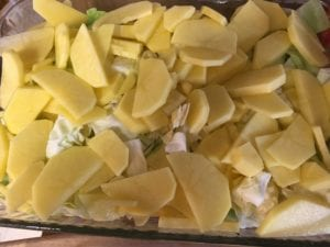 Cabbage and potatoes layered