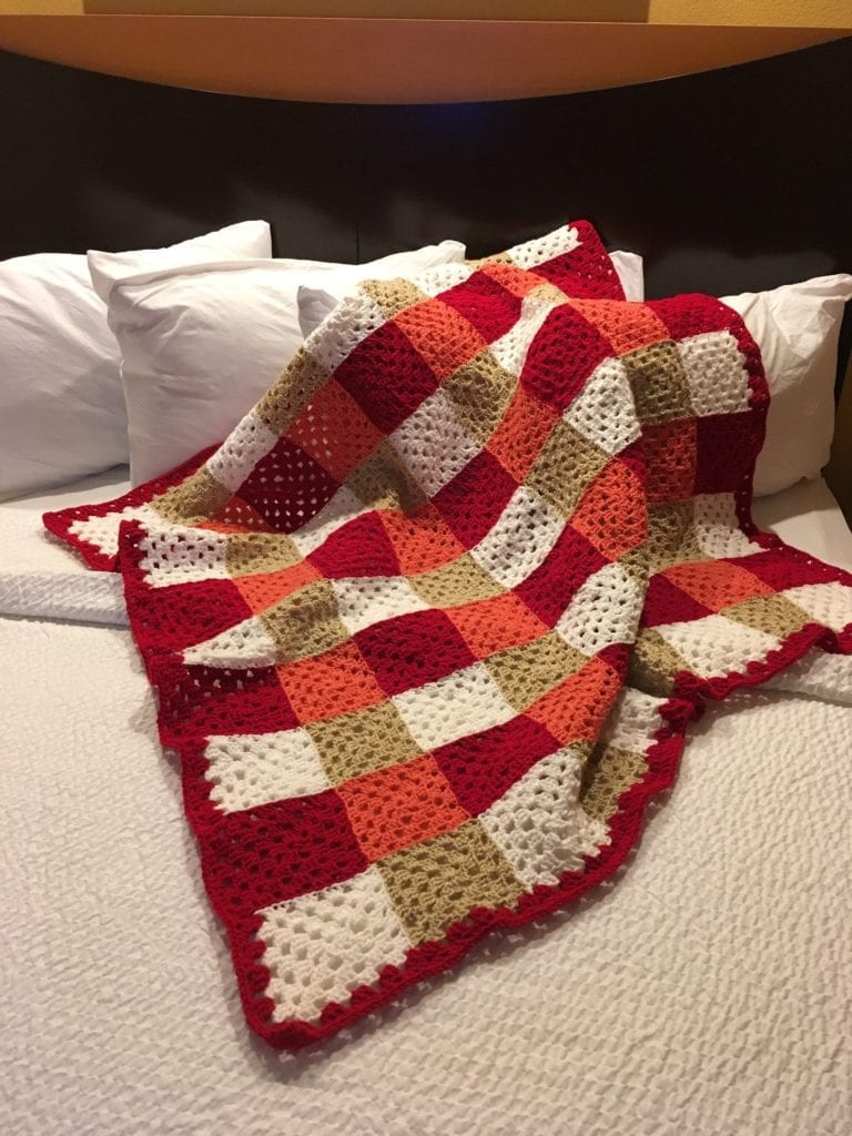 Chic Colorful Granny Square Throw on bed