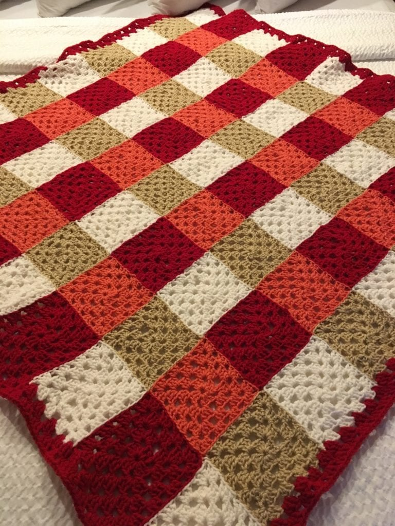 Chic Colorful Granny Square throw laying flat