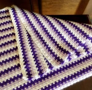 How to crochet a moss stitch baby afghan folded