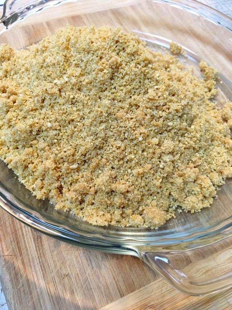 Transferring Graham Cracker Mixture to Pie Plate