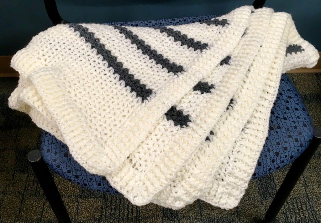Snowy Field Crochet Blanket fanned out