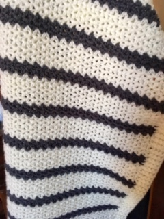 Snowy Field Crochet Blanket hanging