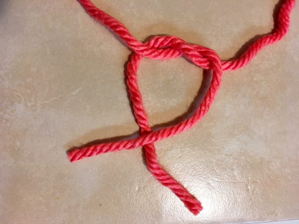 Step 3 of Tying a Square Knot
