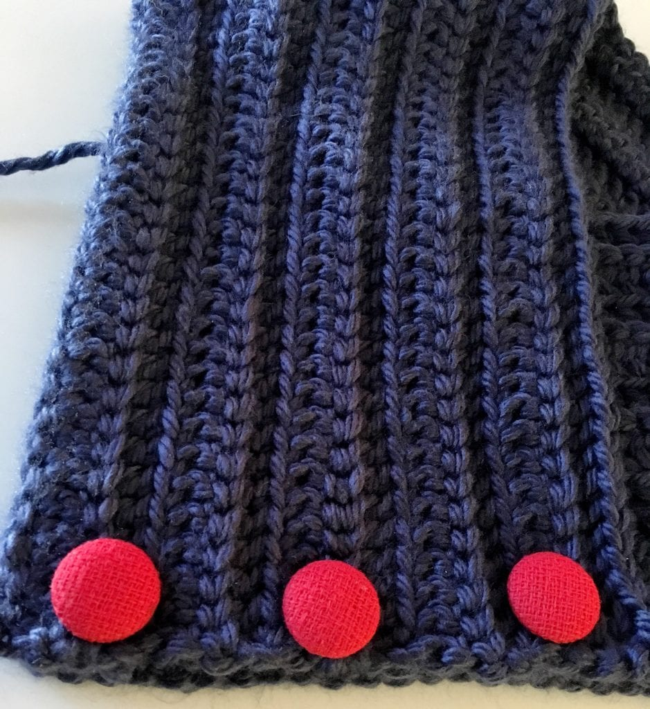 Sewing Red Buttons on Neck Warmer