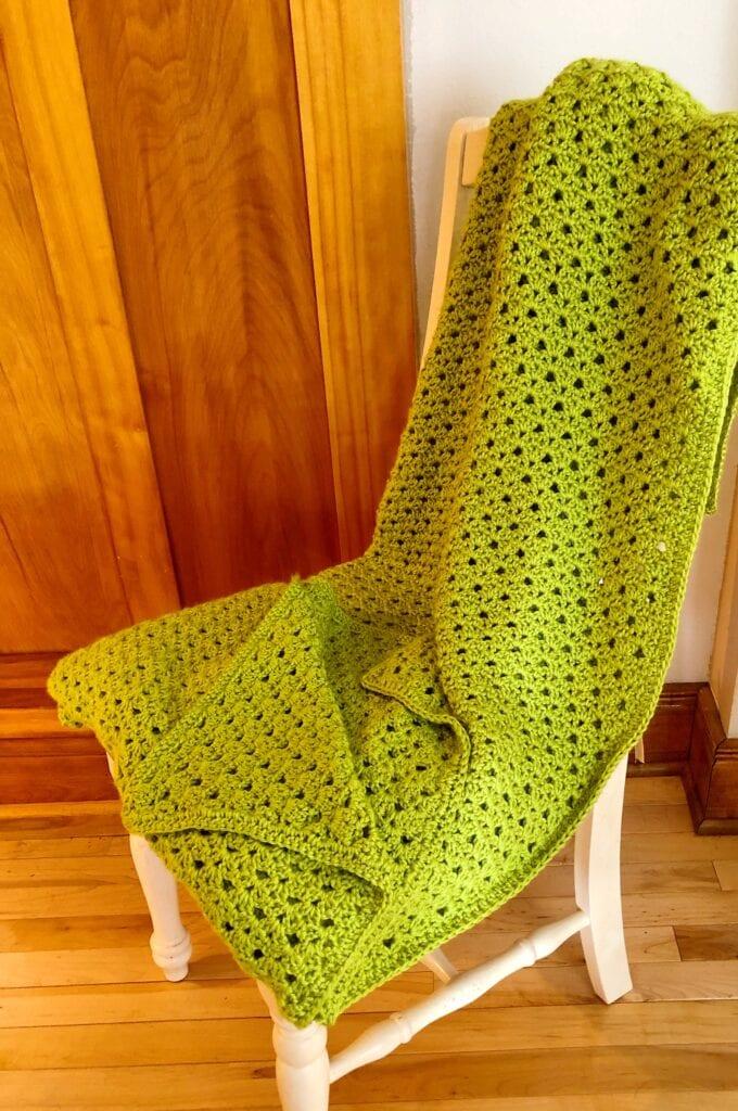 Springtime Crochet Blanket Folded on Chair