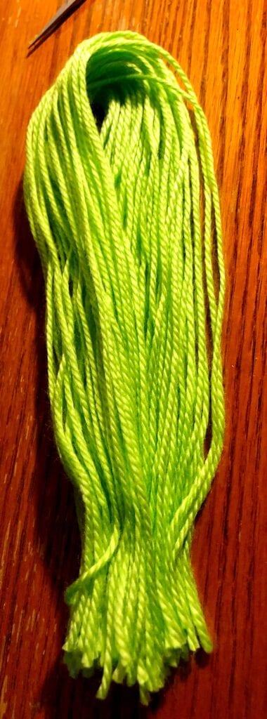 Yarn folded with one end cut.