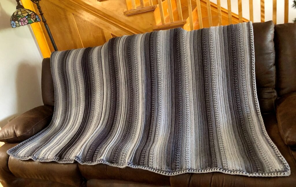 Textured Ombre Crochet Blanket Displayed on Sofa