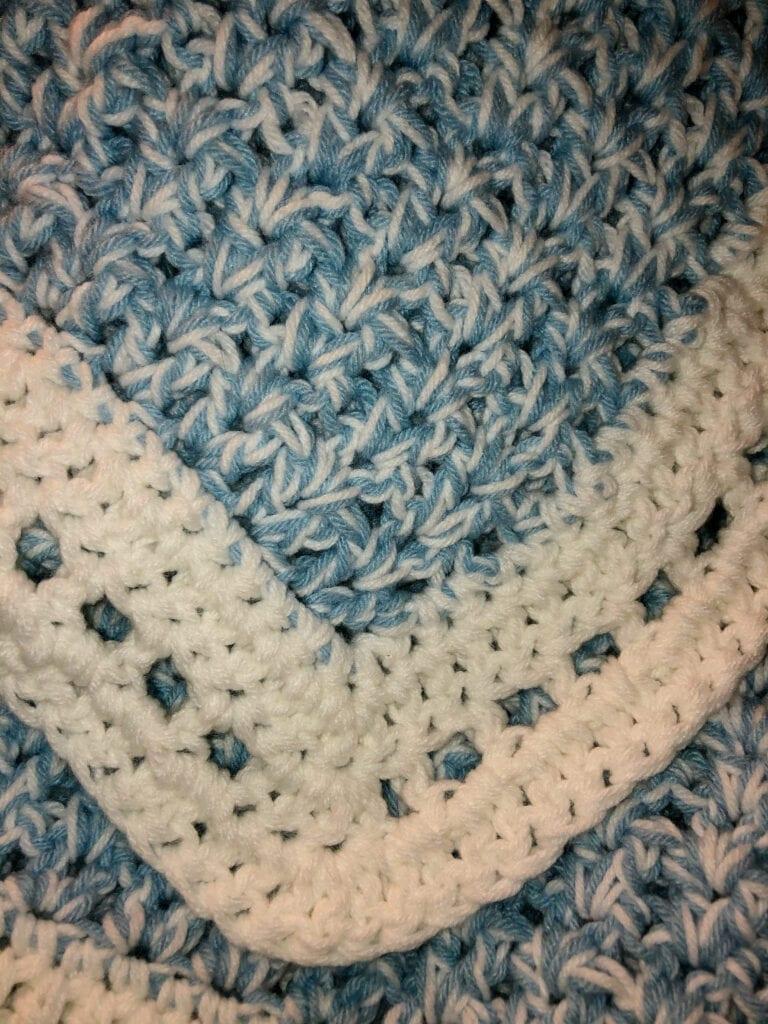 Crochet V-Stitch Blanket with White Yarn for the Last Round