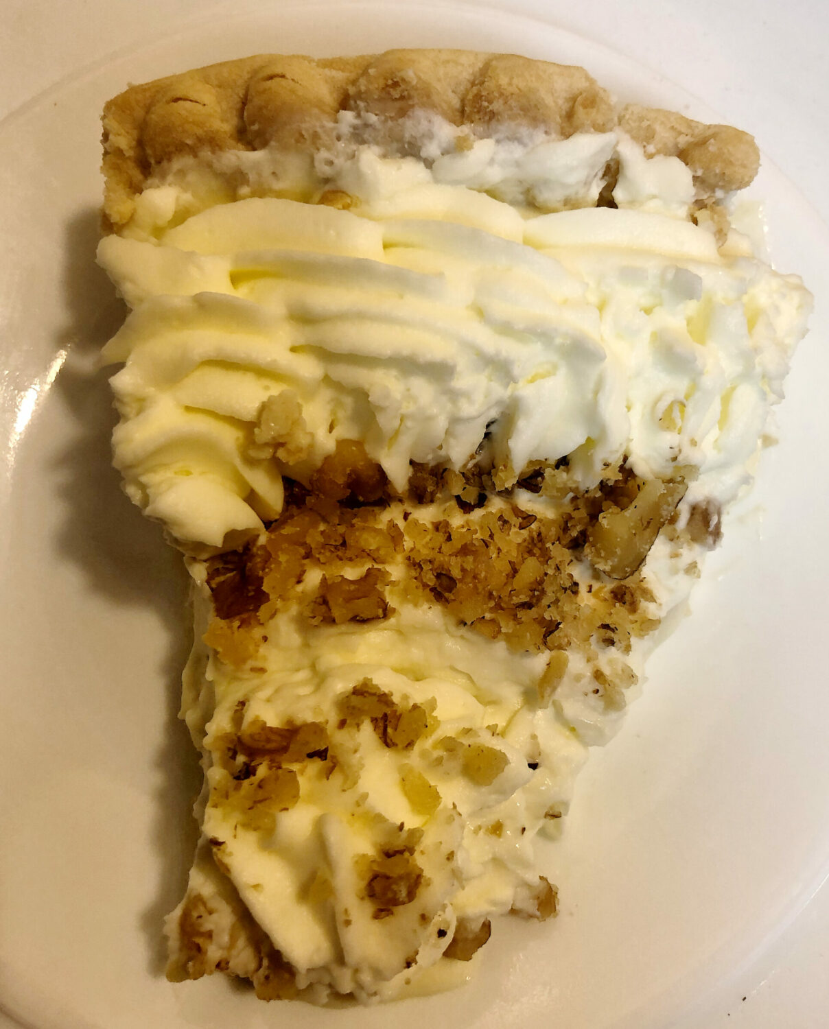 Banana Cream Pie with Whipping Cream and Chopped Pecans