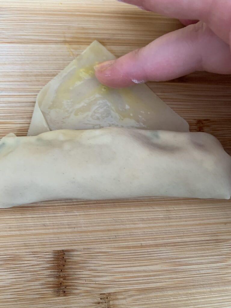 Moistening Egg Roll Wrapper with Beaten Egg