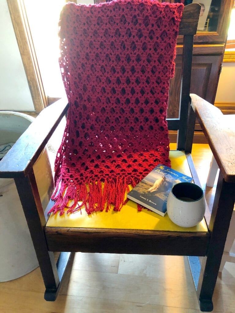 Simply Sophisticated Scarlet Crochet Throw Over the Back of a Rocking Chair a Good Book and Coffee