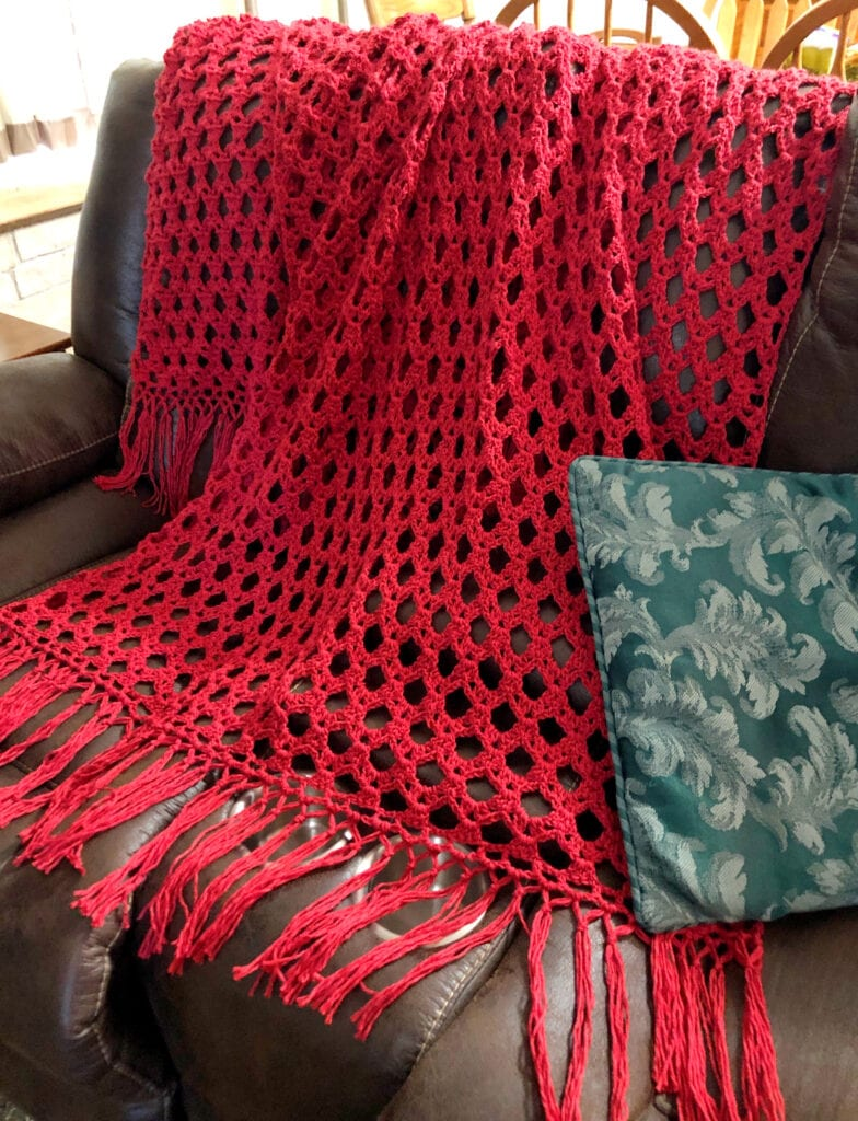 Lacy Crochet Blanket Displayed on Sofa