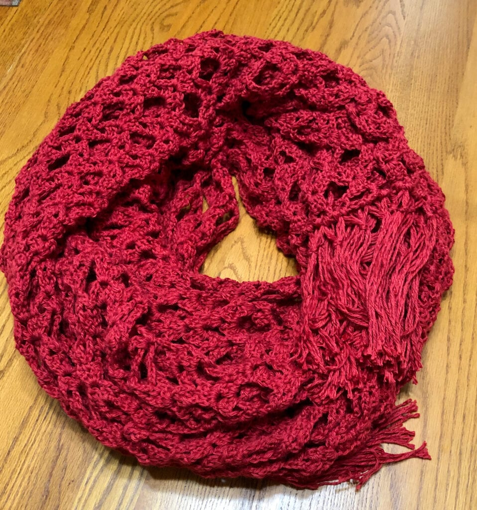 Lacy Crochet Throw Wound into Small Circle Could Be Worn as a Shawl or Wrap