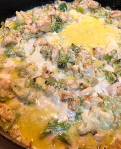 Adding Cream to Skillet of Chicken and Vegetables