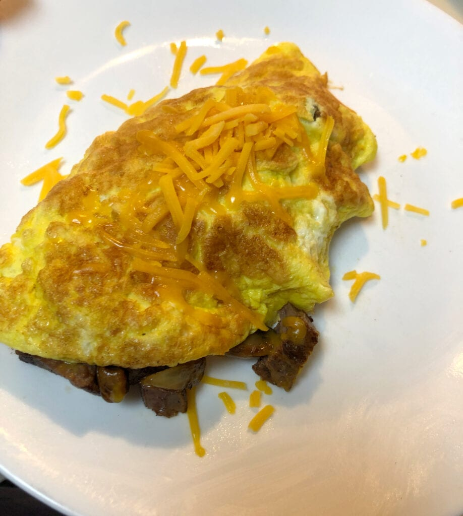 Easy Steak Mushroom and Cheese Egg Omelette Topped with Shredded Cheese