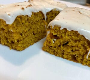 Serving Pumpkin Bars Topped with Frosting