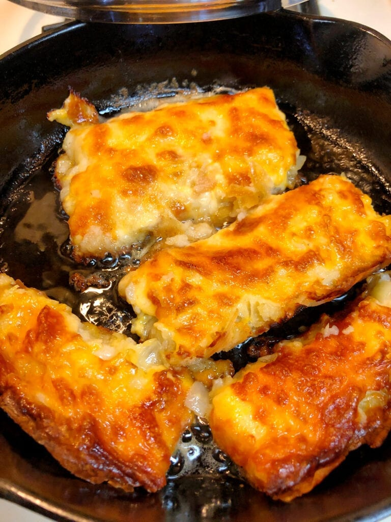Reheating Leftover Cheesy Onion Hash Brown Bake in a Cast Iron Skillet