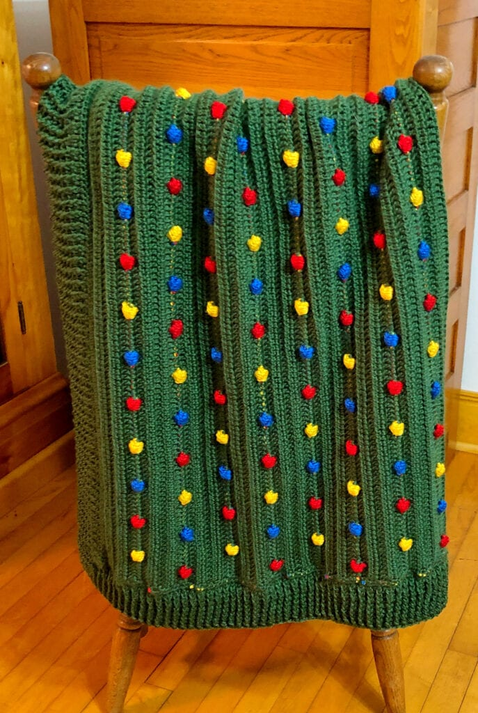 Textured Bobble Blanket Folded on the Back of a Chair