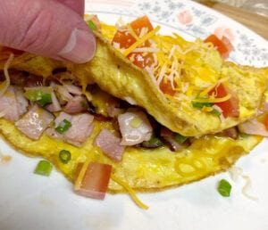 Lifting the Omelet to Show the Scrumptious Fillings