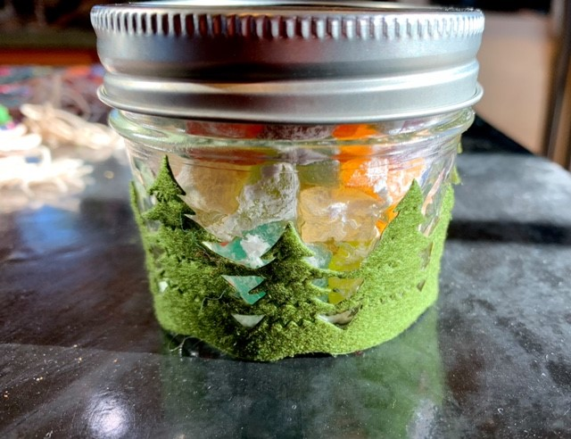 Old Fashioned Rock Candy Jar Decorated with Pine Tree Ribbon