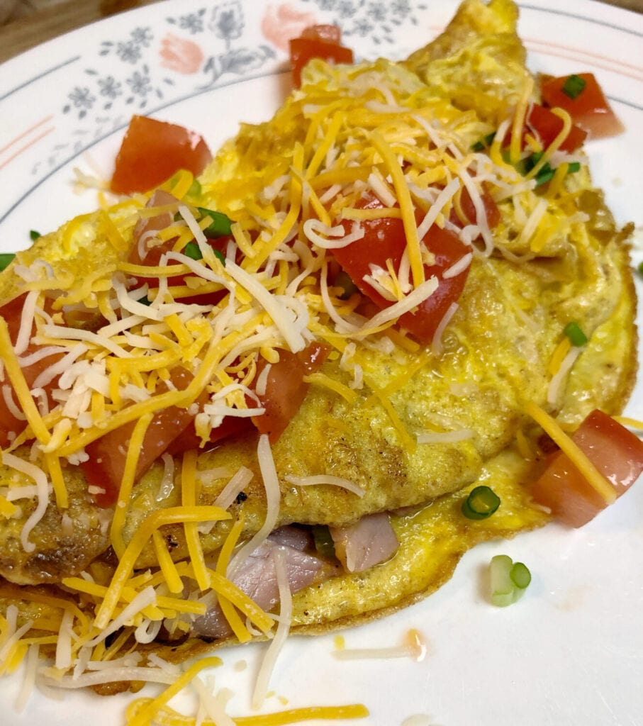 Smoked Ham Omelet with Shredded Cheese Green Onions and Tomatoes