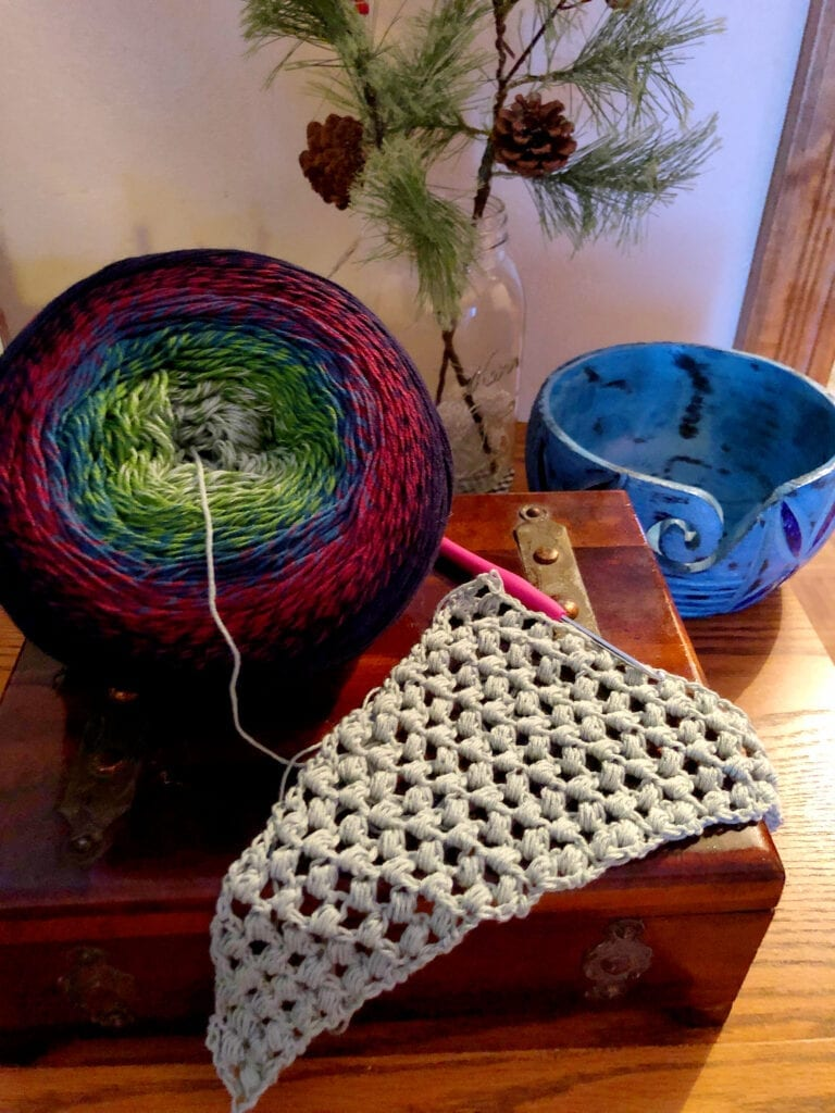 Beginning the Serendipity Crochet Shawl Showing yarn bowl and first 12 inches of shawl
