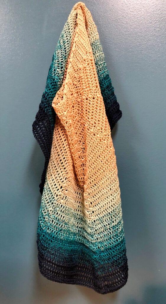 Crochet Beach Shawl Hanging on Hook