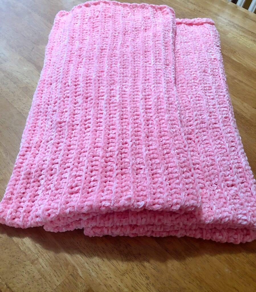 Pink Velvet Blanket Folded on Table