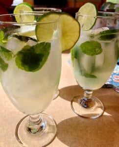 Authentic Mojitos Garnished with Fresh Mint and Lime Slices