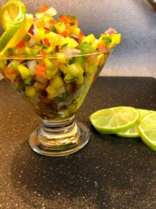 Mango and Tomato Salsa with Lime Slices
