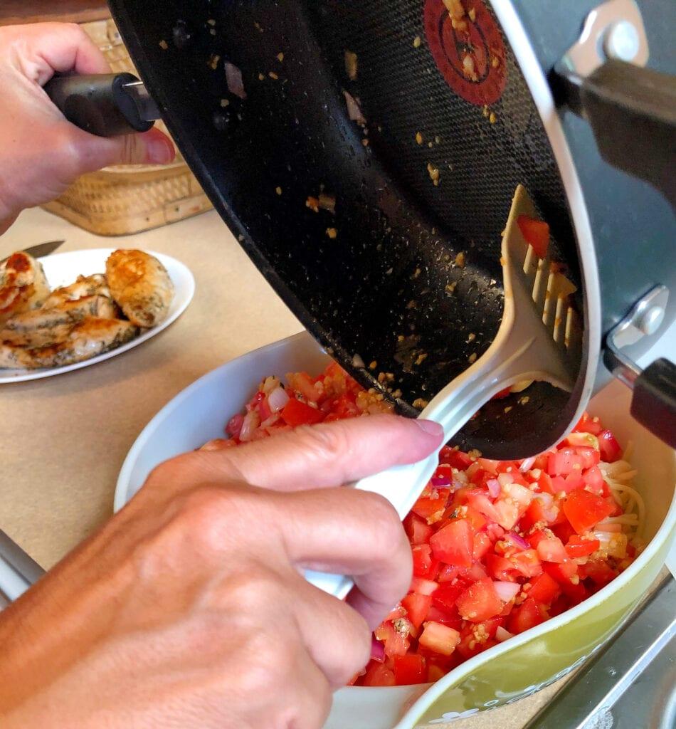 Adding Tomato Mixture to Pasta